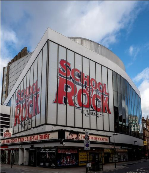 Exterior of Gillian Lynne Theatre, signage says School of Rock