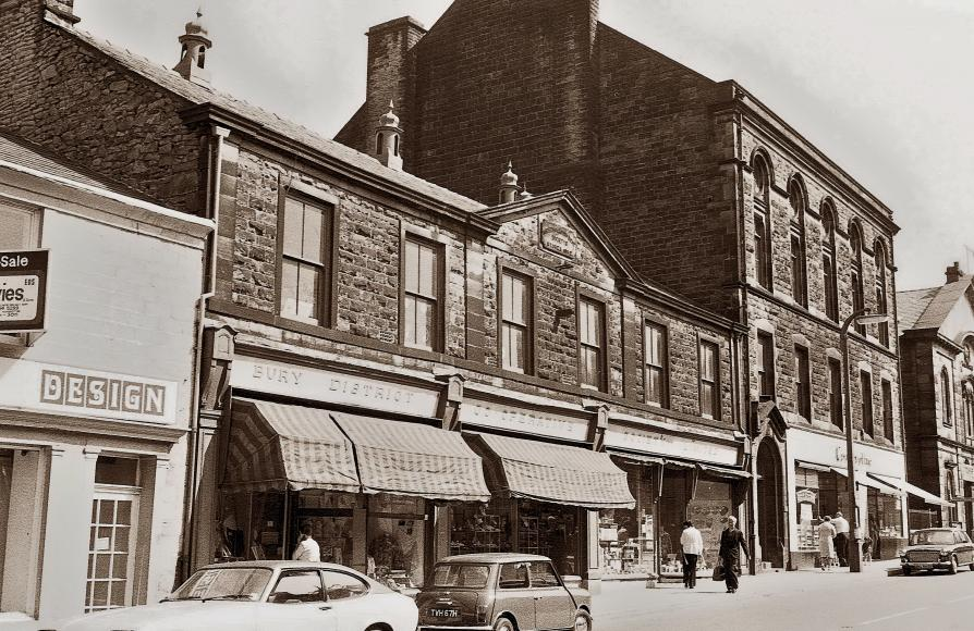 Sepia photo of the streetscape with Ramsbottom Co-op Music Hall